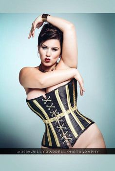 Plus size model, London Andrews in an amazing black and gold corset.