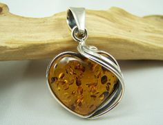 Amber pendant heart shape - cognac amber colour.