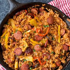 Smoky kielbasa sizzled with sweet bell pepper, onions and garlic in vibrant tomato sauce. This sausage, pepper and rice skillet is downright delicious!