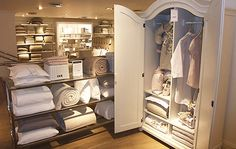 Great use of beige wall color against the white displays! Beige Wall Colors, Beige Walls, Merchandising Displays, Store Displays, Fashion Displays, Home Scents, The White Company, Shelving, White Stuff