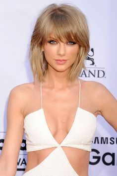 Tons of volume, side-swept bangs, choppy ends; what's not to love about Taylor Swift's new look? If you're thinking about making the cut, invest in a diffuser attachment for your blow dryer and a volumizing foam. Try: Garnier Fructis Full & Plush Root Amp Root Lifting Spray Mousse ($4.29 MSRP)   - ELLE.com