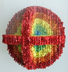 Augusto Esquivel is a Miami-based artist who composes sculptures using hundreds of buttons hanging by wires