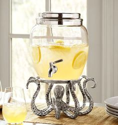 Fun Octopus Stand from Pottery Barn. Now on Sale: http://www.completely-coastal.com/2015/07/4th-of-july-coastal-summer-sales.html