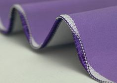 exclusive wave stitch, on either the Evolution or the Enlighten sergers
