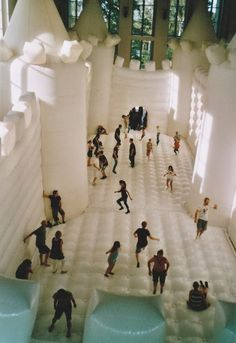 Jump around, jump up jump up and get down :) The White Bounce Castle. William Forsythe, Dana Caspersen and Joel Ryan teamed up to create this concept - which was more about choreography and movement through space, color, sound - and ended up making the guiness book of world records. Originally debuted in 1997 in London it has been popping up as an art installation in different European Cities (last spotted in Berlin in the summer of 2013).