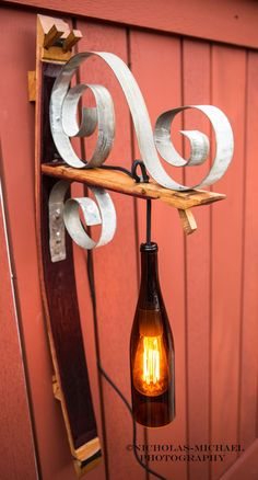 Wine bottle sconce on wine barrel stave by WoodnWineArt on Etsy