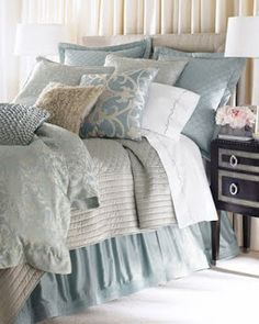 Like this blue, use with the grey and white pallet for cabin bedroom