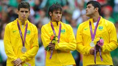 Oscar of Brazil, Neymar of Brazil and Hulk of Brazil look on with their silver medals during the medal ceremony for the Men's Football Final between Brazil and Mexico
