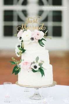 Rough-iced floral wedding cake