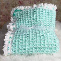 Wrap your precious one is this beautiful handmade crochet baby blanket, baby girl blanket, baby boy blanket. Custom baby blanket uses a waffle stitch technique that results in a beautiful and unique texture. Our Girls baby blanket, newborn baby blanket measures approximately 36 inches by 36 inches. Our blankets for baby is made with acrylic yarn and satin ribbon embellishment. The scalloped edging on this blanket makes a beautiful baby gift, baby shower gift. Although only a green baby…
