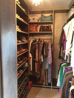 This walk-in closet is part of a His and Hers boutique that uses contrasting material colors and a chandelier.  Designed by professional designer Cassie Alsbach.  Learn more here: https://www.closetfactory.com/custom-closets/ Walking Closet, Custom Closets, Closet Designs, Closet Bedroom, Closet Ideas, Closet Organization, Cassie, Organizers, Bedrooms