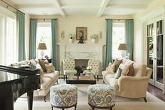 ok...I LOVE the entire set up of this room. Bold prints, long drapes, good seating, this is a home.