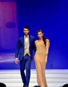 An #elegant look for a perfect #couple with a blue shiny #suit and a #camel tonned sleek long #gown