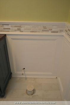 wainscoting with tile border. Just make the tile white, vertically placed, white an opal shimmer