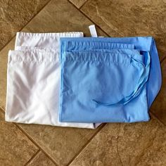 Bundle of Scrub Pants You get 2 pairs of pants (white & blue) all have drawstring waist, side thigh pockets & 1 back pocket, white pair are in good condition with wear at the bottom heel area, blue pair are in excellent condition with one faint mark near top of pant. Pants