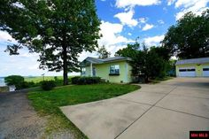 Possible owner financing. Shared well on association. Year-round lake view. Well house on property owned by association in Mountain Home AR
