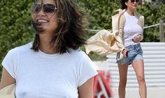 Chrissy Teigen wears revealing white top