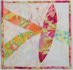 Sarah Ann Smith created this quilt for Janome. The detail that she puts into her quilts are amazing and all done by hand. Unfortunately, pictures do not do them justice. Check out more of her designs at http://www.sarahannsmith.com/