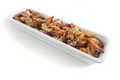 Roseval aardappel uit de oven, met rozemarijn, tijm, knoflook en ui.