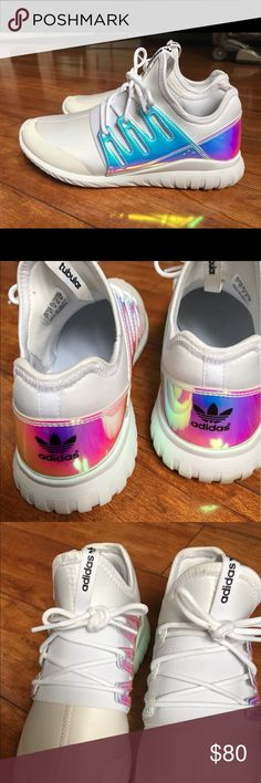 Adidas Holographic Tubulars Super rare Holographic Adidas Tubular Tennis Shoes. White/off white soft outer material. . A tad discolored in the front but hardly noticeable. No stains and still very cute. Fits great. Very comfy. Very hard to find. Fits like a Women's 7.5/8 adidas Shoes Sneakers