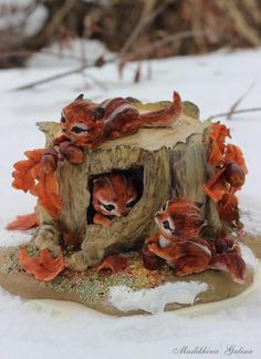 Chipmunks on an old stump by Galina Maslikhina