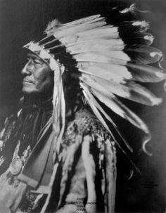 Chief Eagle Thunder, a Native American (Sioux) man - Frank A Rinehart - 1900