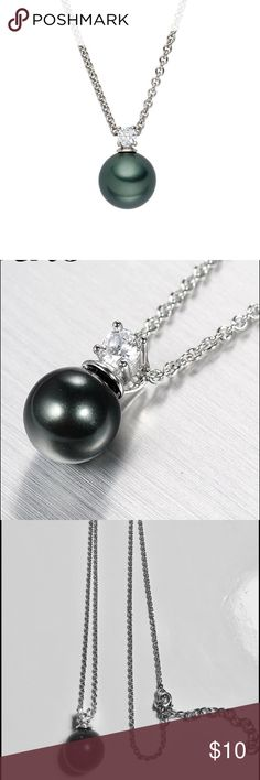 "Black Pearl Crystal Pendant Silver Plated Chain Thank you for viewing this item. I'm selling these Elegant Black Pearl and Crystal Pendant Necklaces. They have a Classic look that will always be in style and I'm selling them at an amazing price. The Pearl is 12mm and the Crystal is a Round Brilliant Cut. The Chain is Silver Plated and 16""-18"" adjustable. All items are 100% Brand New & Quality! Jewelry Necklaces"
