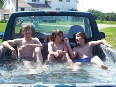 Pickup truck swimming pool. You know you are a Redneck when...