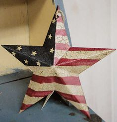 Primitive Americana Barn Star with Crackle Antique Finish  $2.49  Item# 656386  Decorate your home with this great antique look Americana primitive barn star! Hang in a wreath, use as an ornament in a patriotic themed Christmas tree.     Star is made of metal and is dimensional. It is painted and then a wonderful crackle finish is applied giving it an aged worn look and beautiful patina!     Fully assembled and finished as shown     Price is for one star.