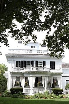 Old colonial with curtained porch