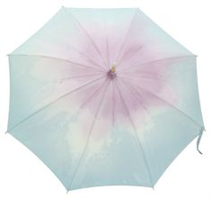 This umbrella reminds me of the beautiful colors from the movie Umbrellas of Cherbourg by Jacques Demy ...