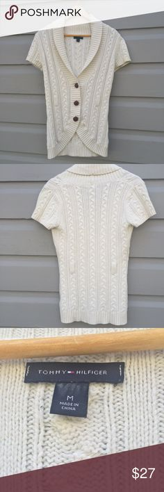 Tommy Hilfiger cable knit short sleeve cardigan Tommy Hilfiger size medium in cream. This knit sweater has a short-sleeve so it functions perfectly for transition into fall. Oversize leather button closure, hidden belt loop allows for easy styling, and beautiful off white pairs with absolutely everything. Excellent condition. Tommy Hilfiger Sweaters Cardigans