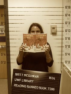 """Meet Librarian Britt """"Big Teach"""" McGowan!  She's all about Freadom, reading The Catcher in the Rye by J.D. Salinger just for kicks! That's right - it's one of many books that have been challenged. Find out more in our Banned Books libguide: http://libguides.uwf.edu/BannedBooks #bannedbooksweek"""
