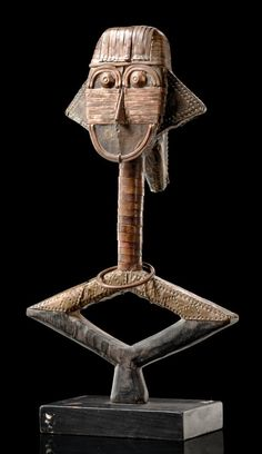 Africa | Reliquary figure from the Kota people of Gabon | Wood, brass and copper sheet