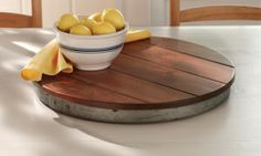 There's nothing lazy about this versatile Orvis Wine Barrel Lazy Susan made in the USA from the top of a solid pine wine cask.