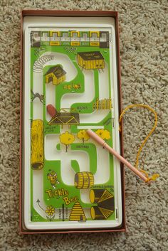Tickle Bee.( I loved my Tickle Bee, I wish I still had it.)  You guided the bee through the maze using the magnet on a stick.