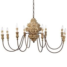 Antique wood carved chandelier by Regina Andrew Design.