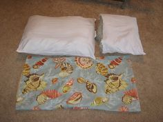 Fake-It Frugal: Fake King Size Pillow Stuffers - Simply cut a regular-sized pillow in half and stuff it into the sham with one regular pillow!  Don't throw away your old pillows - use them again!
