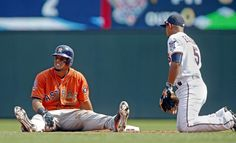 Take a seat -  Houston Astros' Carlos Gomez, left, remains seated momentarily after he was tagged out on a pickoff by Minnesota Twins shortstop Eduardo Escobar in the second inning on Aug. 30 in Minneapolis. The Twins won 7-5. -  © Jim Mone/AP