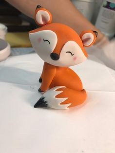 Sweet little fox, made of fondant with edible paint and edible colored dust accents