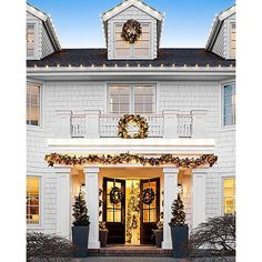 """@kathykuohome's photo: """"Are you ready to open your doors for the holidays ❄️ What a beautiful exterior featured in @traditionalhome and designed by @kristispouseinteriors. Remember our Holiday Shop is open and ✨ 20% OFF SITEWIDE ✨ with the code SHOP20 #kathykuohome #interiordesign"""""""