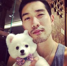 Godfrey Gao (Korean model)    I know he's not Kpop -but he's HOTT and the puppy is soooooooo cute!! He looks like a little teddy bear!!