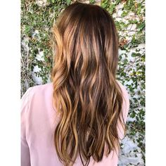 Brunettes, this one's for you: Inspired by the tiger-eye stone, with its silky mix of golden and brown stripes, this hair trend involves painting caramel highlights over a warm or dark chocolate base. We're gonna go ahead and call this a universally flattering look.