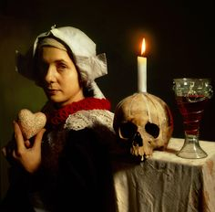 This is a really interesting photographic interpretation of a Vanitas.  The woman is dressed in the period when Vanitas was a popular subject matter.  The heart she is holding is interesting.  It reminds me of the heart of the book, that heart of something hopeful that perhaps everyone in the play is holding.