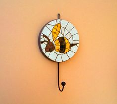 Decorative mosaic hanging hook with abstract bee pattern