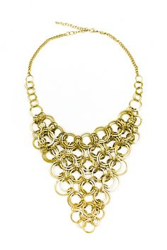 The Santana is made up of antique multi-sized gold interlocking hoops - it's a Christian favorite! This magnificent statement necklace looks fantastic when worn with a simple black top for a sexy, original look that only a trendista could pull off. Santana draws all eyes to you—but you keep them there. Available at sendthetrend.com.