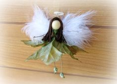 Check out this item in my Etsy shop https://www.etsy.com/listing/256924355/flower-fairy-faerie-ornament-angel