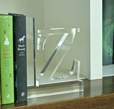 Loving these fabulous lucite bookends!! Makes a big statement while also being functional! Happyvalleygoods.com