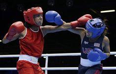 Venezuela's Karlha Magliocco fights Marlen Esparza in a women's flyweight 51-kg quarterfinal boxing match.