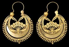 """Traditional portuguese filigree earrings, from Viana do Castelo, called """"arrecadas"""". This is one of the few cases in which jewelery of the privileged classes imitated popular pieces of jewelery. Currently it is circular in shape, with a moon shaped part, filigreed """"SS"""", closing with an inverted triangle. They are made with open filigree, sometimes they have a Viana bead in fitting, or have beads all the way around (usually five)."""